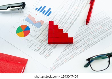 Financial documents, with green cubes arranged in a column graph as a concept for expenses , capital or assets