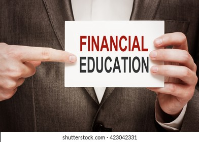 Financial Education. Man holding a card with a message text written on it.