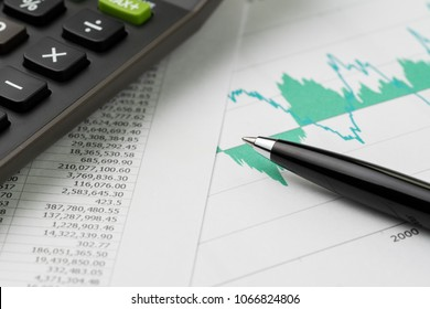 Financial equity, stock exchange price index, budget, economics or investment concept, pen on graph and chart print paper with calculator on price numbers report on table.