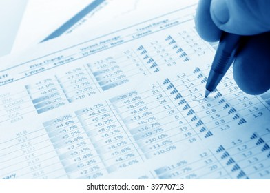 financial figures and pen