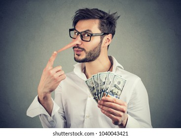 Financial fraud concept. Liar business man with dollar cash