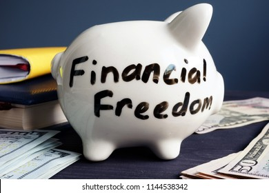 Financial freedom written on a side of piggy bank.