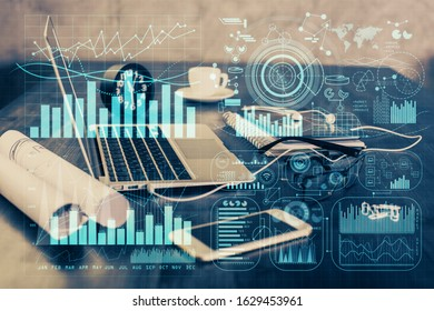 Financial graph colorful drawing and table with computer on background. Double exposure. Concept of international markets. - Shutterstock ID 1629453961