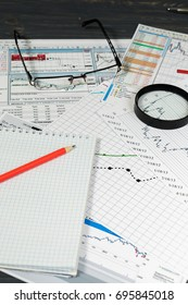 Financial graphics loupe and pencils