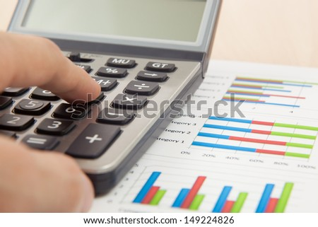 Financial graphs and charts with calculator