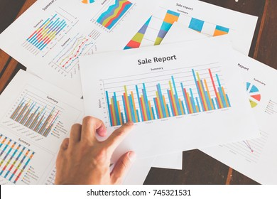 Financial graphs and charts on wooden table