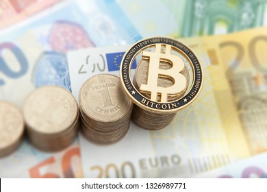 Financial growth concept. Histogram with coins and Bitcoin in euro background. Photo new virtual money.