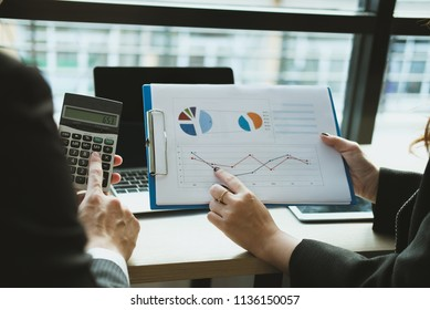 financial inspector analyze accounting plan report. businessman working with new startup project. internal auditor audit performance revenue. business meeting at workplace.