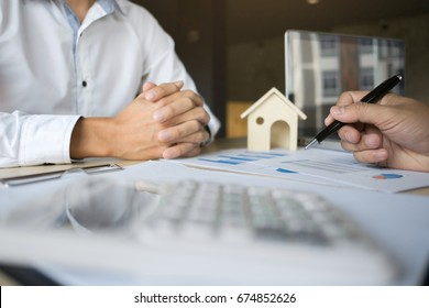 financial inspector making report,insurance agent analyzing about home investment loan at office room