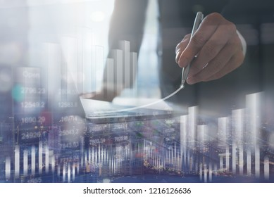 Financial investment, business analysis concept. Double exposure of businessman analyzing stock market or forex graph and financial background. Economy trends. Finance background for business design