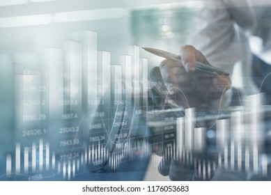 Financial investment concept. Double exposure of businessman and stock market or forex graph, blue tone. Economy trends background. Abstract finance background for business design or presentation.