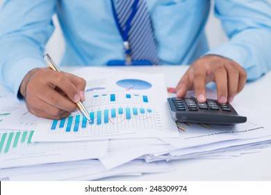 Financial manager analyzing charts and graphs