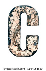 financial news  newspaper cut up into confetti  to make  the captal letter,C