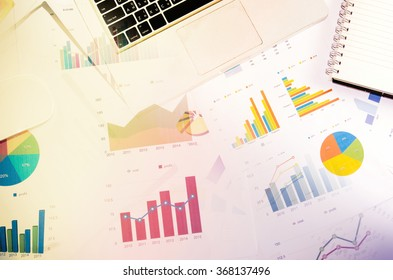 Financial paper charts and graphs on the table.Business Concept