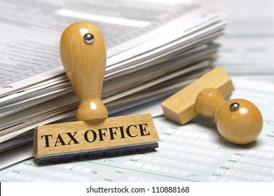 financial paper documents with rubber stamp marked with tax office