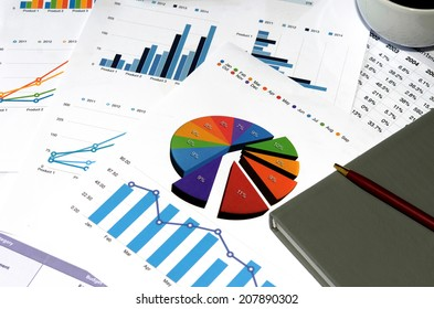 Financial papers, book and office supplies closeup
