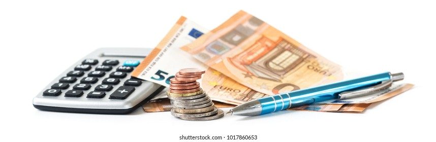 financial planning with coins and euro banknotes, a calculator and a pen isolated on a white background, panoramic banner format, selected focus, narrow depth of field