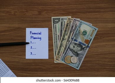 Financial Planning words written on paper note on wooden table with dollar cash,  bank statement, and pen, Finance saving investment concept