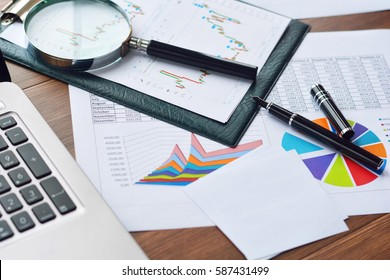 Financial printed paper charts, computer, graphs and diagrams