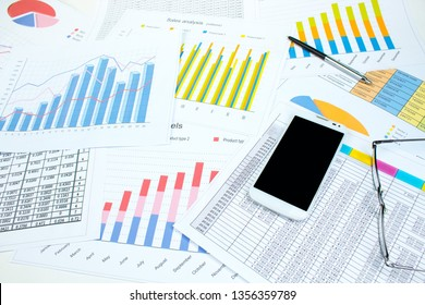 Financial printed paper charts, graphs and diagrams on the table