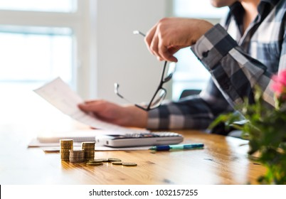 Financial problems, recession, bankruptcy or foreclosure concept. Unhappy sad man reading letter, bill, bank statement paper or tax document. Stress, depression and fail. Debt, inflation and crisis.