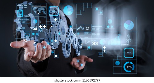 Financial report data of business operations (balance sheet and income statement and diagram) as Fintech concept.businessman hand showing gear to success concept as concept