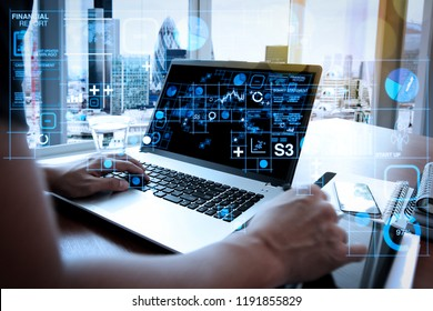 Financial report data of business operations (balance sheet and income statement and diagram) as Fintech concept.businessman hand working with new modern computer and smart phone.