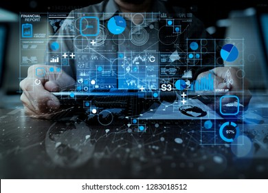 Financial report data of business operations (balance sheet and income statement and diagram) as Fintech concept.businessman hand working with modern technology digital tablet computer.