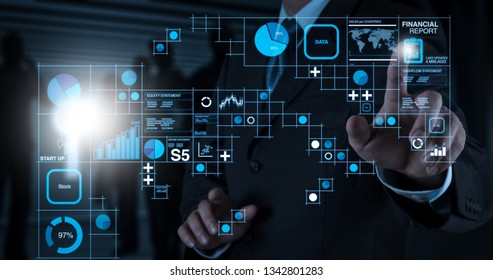 Financial report data of business operations (balance sheet and income statement and diagram) as Fintech concept.Businessman hand pressing an imaginary button on virtual screen