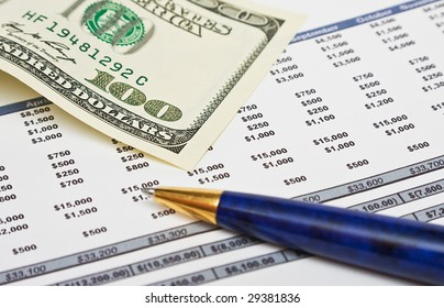 Financial report with pen and dollar bank note