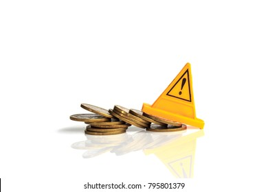 Financial risk. Coins falling and Warning label on whitebackground