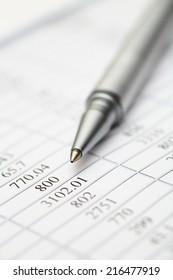 Financial statements. Ballpoint pen on financial statements.