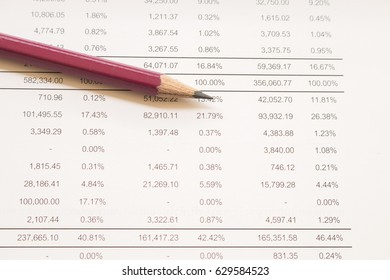 financial statements for business and working at office desk