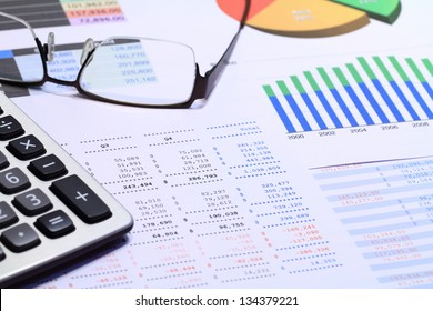 Financial statements review and analyze with colorful charts and tables.
