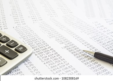 Financial statements, summary reports with modern pen and calculator. Concepts of accounting, audit evaluation, tax planning and business marketing.