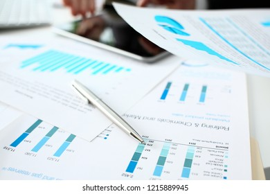 Financial statistics documents ball pen infographics at office table closeup. Internal Revenue Service inspector sum check investigation exchange market earnings savings loan and credit concept