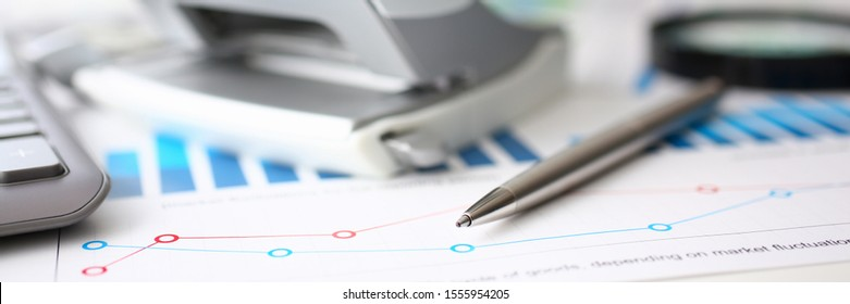 Financial statistics documents ball pen infographics at office table closeup. Internal Revenue Service inspector sum check, investigation, exchange market, earnings, savings, loan and credit concept