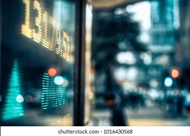Financial stock market numbers and city light reflection