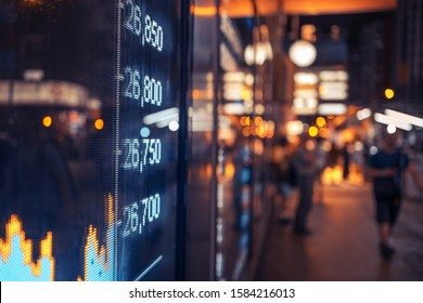 Financial stock market numbers and city lights