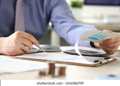 Financial Tax Report Man Calculating Vat Expenses. Professional Bookkeeper Checking Debt Paper Graph. Audit Concept. Businessman Counting Money Using Calculator. Analyzes Economy Invoice