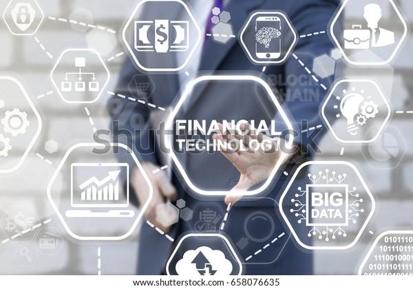 Financial Technology Business Banking Insurance Investment Concept. FINTECH. Businessman presses FINANCIAL TECHNOLOGY text button on virtual screen. Finance innovative technologies.