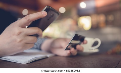 Financial technology (fintech) payment online shopping with debit card on smartphone mobile transaction