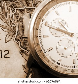 financial time concept with money and watch