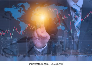 Financial trading stock concept with businessman using technology to check worldwide market stock data over cityscape night view, IOT internet of things concept