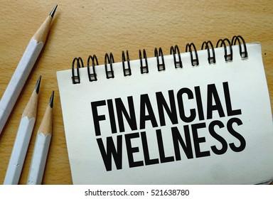 Financial Wellness text written on a notebook with pencils