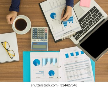 financial worker analyzing statistical data on desk in office. top view. above view. Accounts concept.