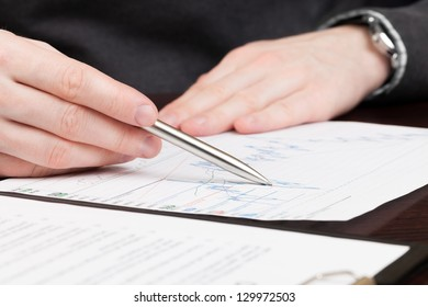 Financial world with business people and everything related to it - signing document