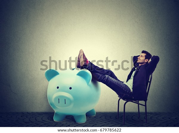 Financially successful business man sitting in chair and relaxing