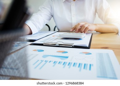 financier calculating a number in data documents at office.
