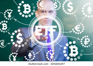 Financier presses etf button on a virtual interface. ETF - Exchange Traded Fund. Trade Market ICO IPO Financial Technology Network Web Business Investment concept.